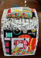 http://www.patchworkposse.com/arm-chair-pin-cushion-and-sewing-pocket-tutorial/