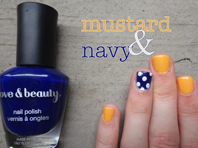 mustard yellow nail polish with blue accent nail, polka dots