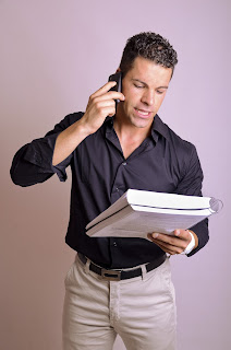 Man on the phone reading a script