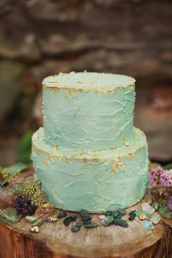 Light green buttercream weddign cake with gold flecks