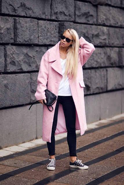 Street style with a pink coat over a black and white outfit