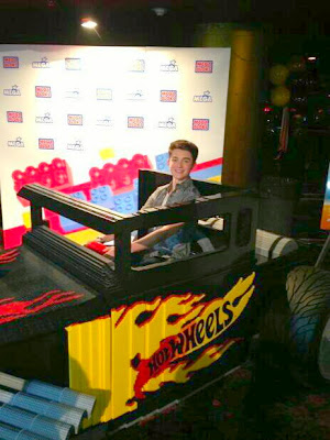 "Greyson Chance in a big ""Hot Wheels"" car"