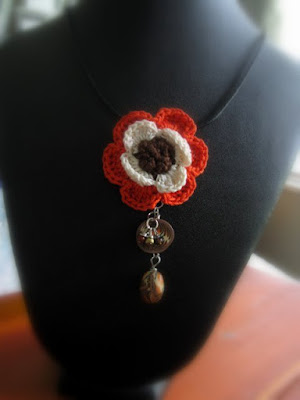https://www.etsy.com/listing/236866713/crochet-flower-necklace-orange-beige-and?ref=shop_home_feat_1