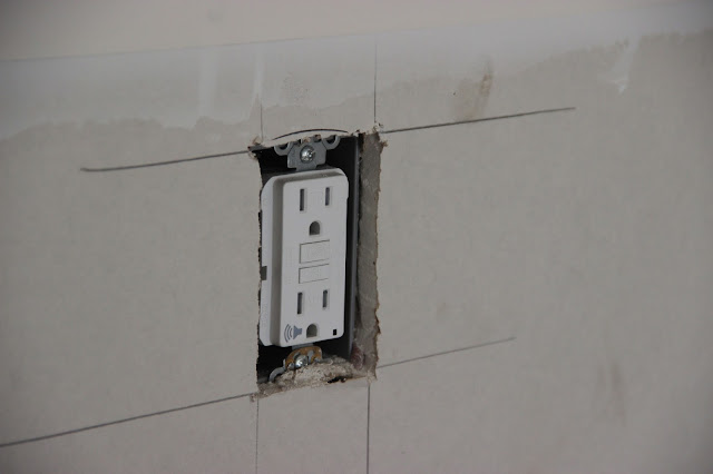Electrical outlet being installed