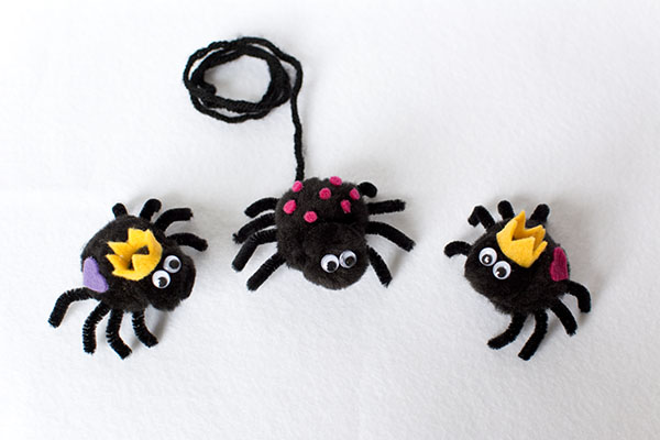 Cute black pom pom spiders with googly eyes and felt embellishments to make crowns, spots and hearts. King queen princess prince spiders
