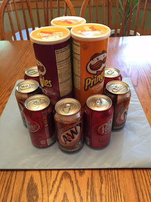 Pop cans around pringles