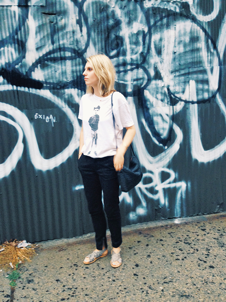 Black ankle brocade trousers, flat zebra print sandals, Bottega Veneta intrecciato cross body leather bag, casual loose t-shirt, Marc Jacobs tee, blond bob, graffiti wall, Brooklyn New York