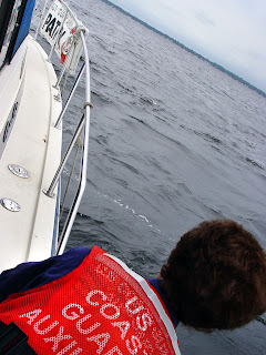 Auxiliary Member on Boat on Patrol