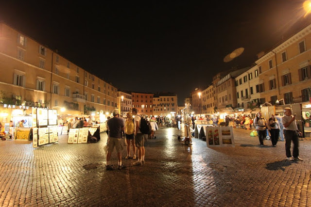 You can find different types of paintings at Piazza Navona in Rome, Italy