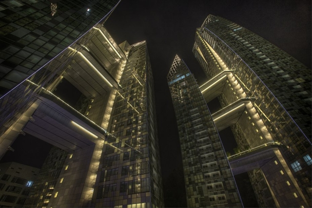 Looking up at Reflections at Keppel Bay by Studio Daniel Libeskind at night