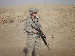 ME standing Guard on Patrol in Iraq
