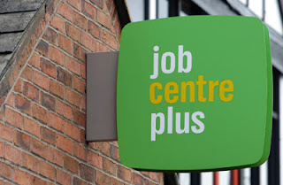 Job Centre Plus sign attached to the gable end of a building