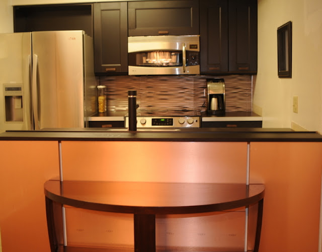 CD Rack as a backsplash and copper wall