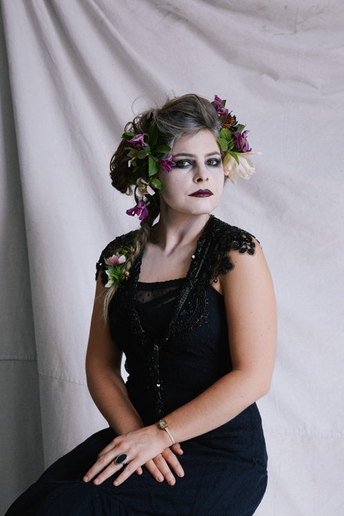 Vanitas Halloween costume recipe. Flowers, grey hair, make up, black dress.