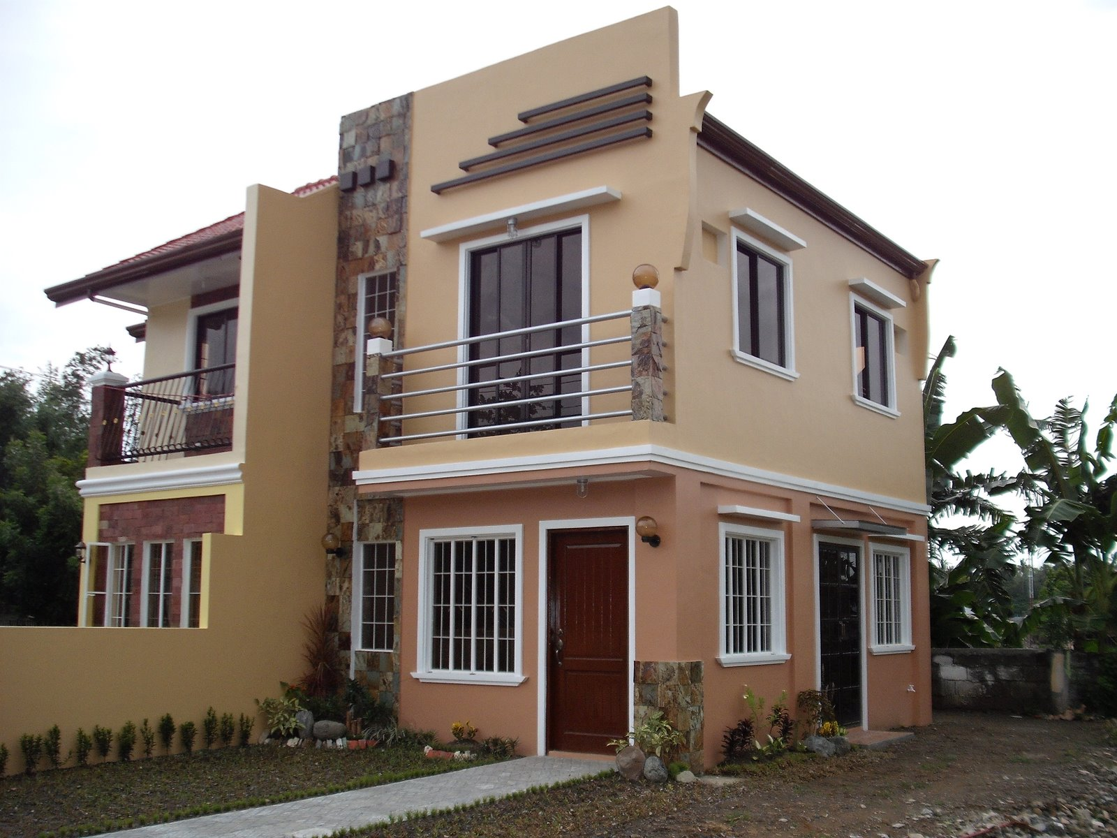 Royal residence iloilo by pansol realty and development for Duplex house models