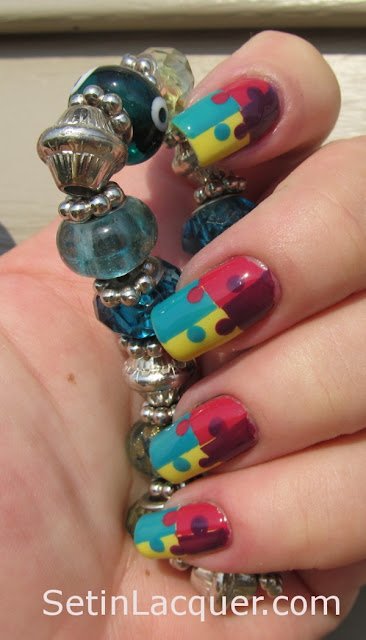 Scotch tape and dotted puzzle pieces nail art