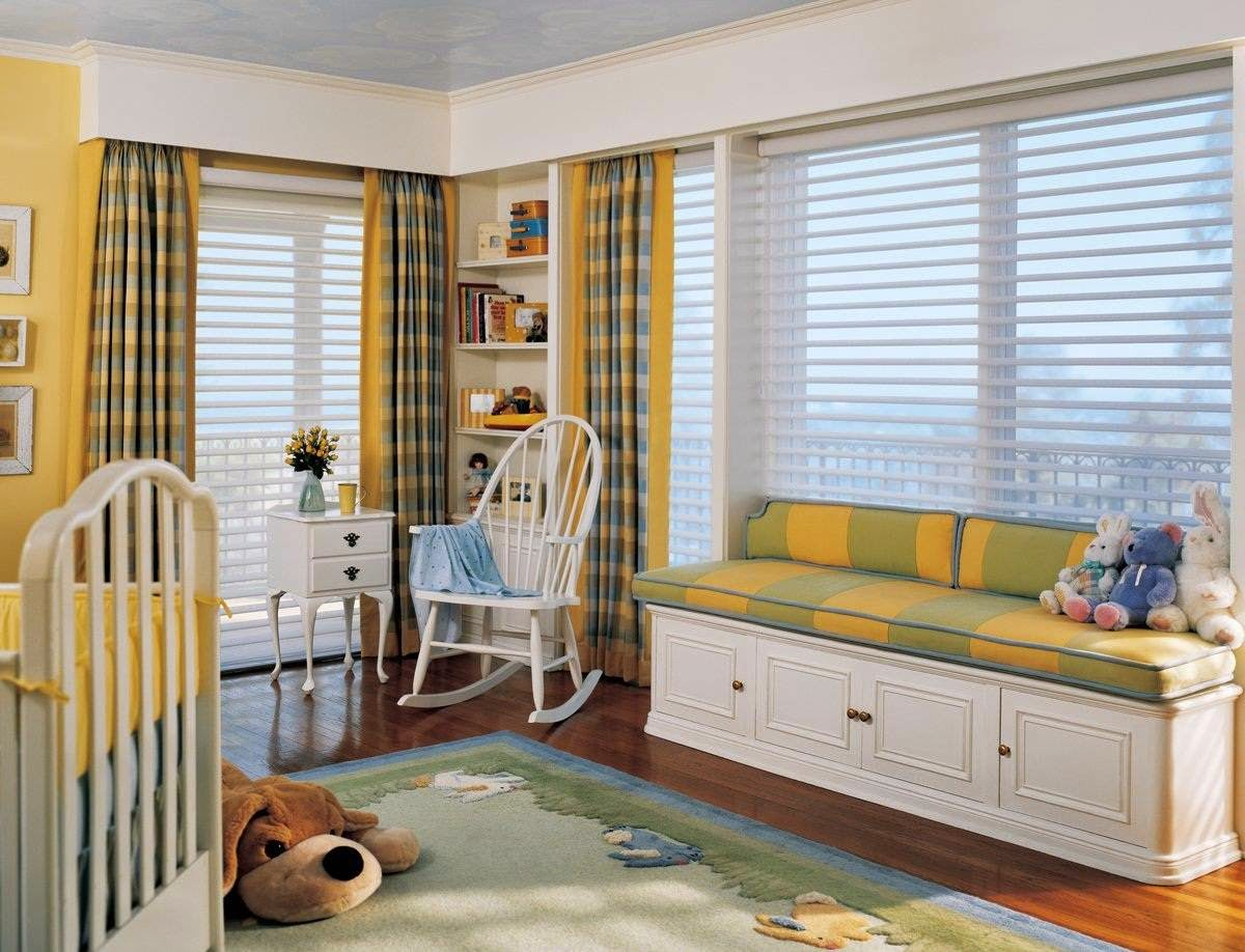 Bay window seat in the nursery room idea