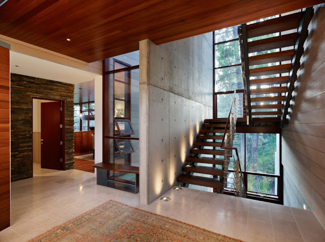 Concrete walls and wooden staircase