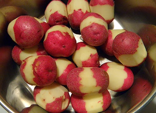 Parially Peeled Potatoes in Pot