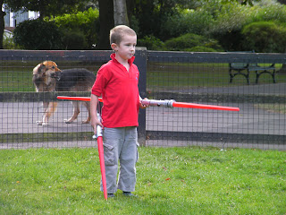 heavily armed child with double ended light sabre