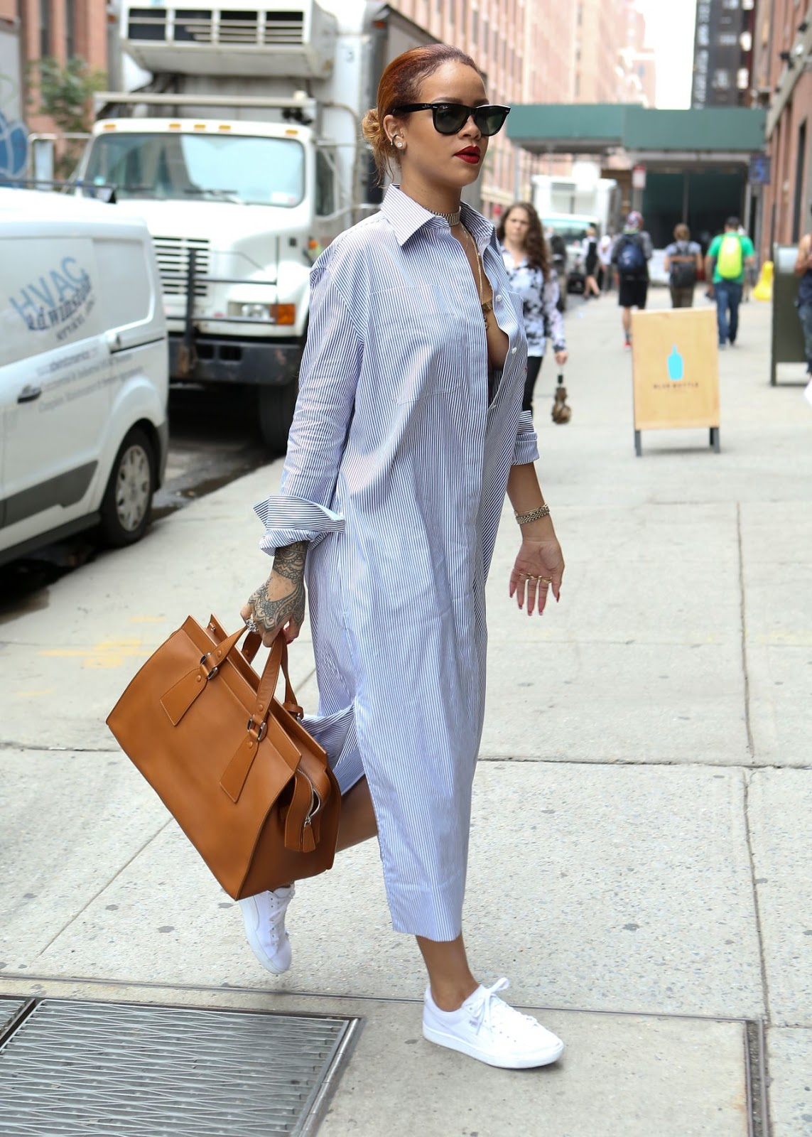 Rihanna goes braless in a shirt dress in New York City