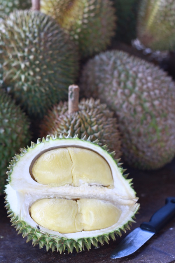 balik pulau durians cut open on roadside stall