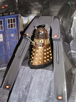A Dalek patrols the saucer ramp