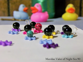 DIY octopus beads; cute little craft using beads and glue. Octopus bead invasion.