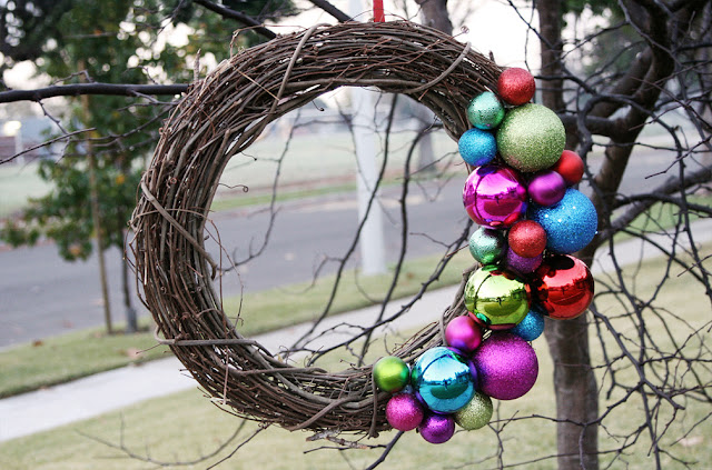 simple rattan christmas wreath with assorted asymmetric baubles