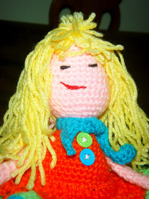 crochet doll handmade face closeup