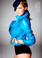 Kate Upton in a blue leather jacket and black panties