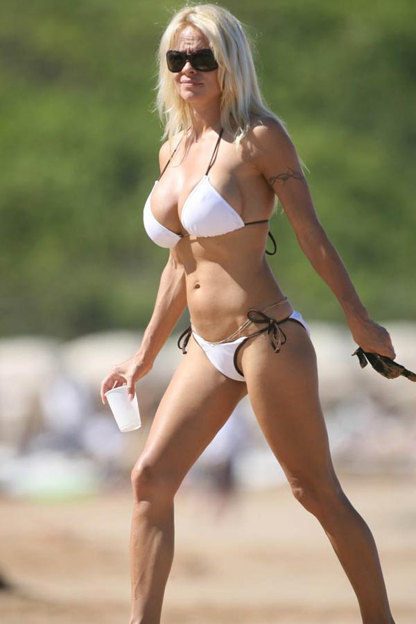 With her athletic body and Dark blond hairtype without bra (cup size 36E) on the beach in bikini