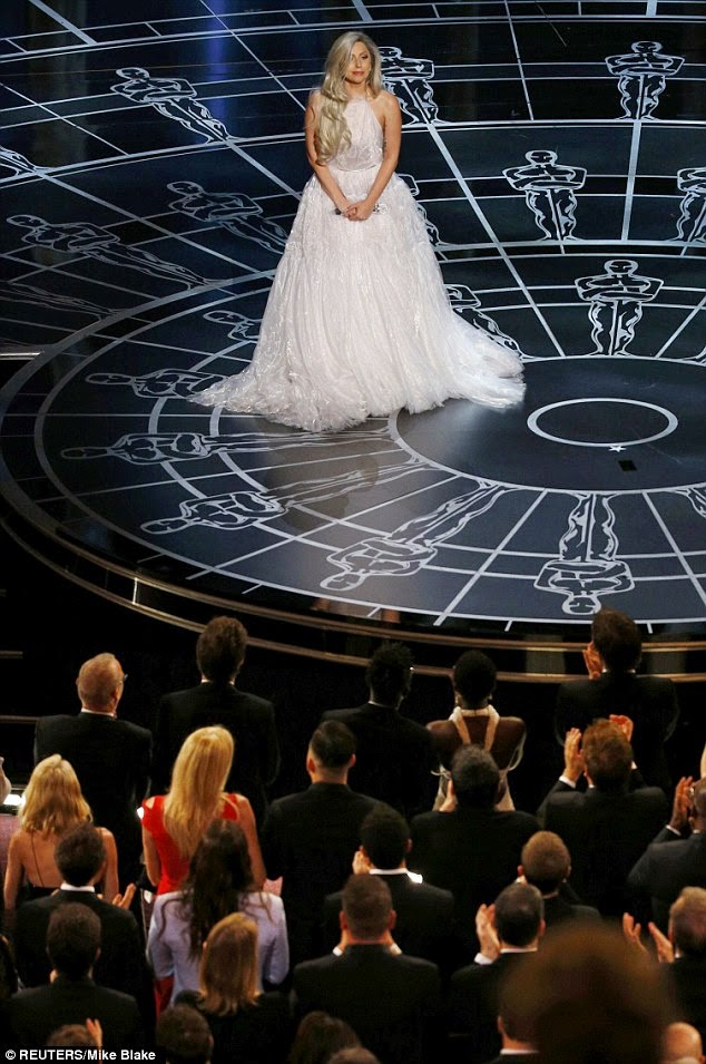 Lady Gaga performs in a bridal inspired gown at the 2015 Oscars in Hollywood