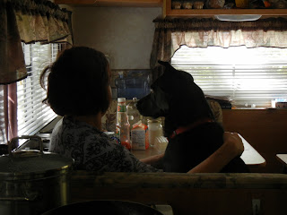 Pattie and Chloe enjoying breakfast in the travel trailer