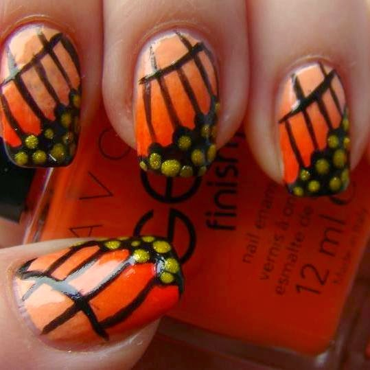 http://prettynailsbykasia.blogspot.com/2014/10/31dc2014-day-2-orange-nails-butterfly.html
