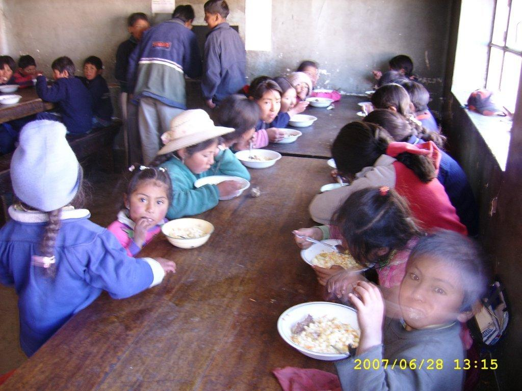 The children get their meal from the parrish