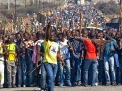 80,000 South African Platinum Miners Strike For A Living Wage. (Screen capture from YouTube video)