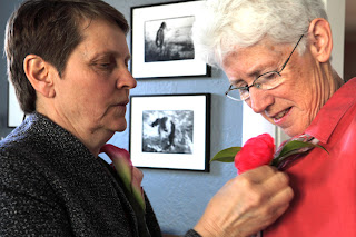 Chris pins flower on Jill - Patricia Stimac, Seattle Wedding Officiant