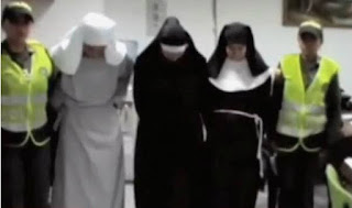 Screenshot of the fake nuns at a Colombian airport
