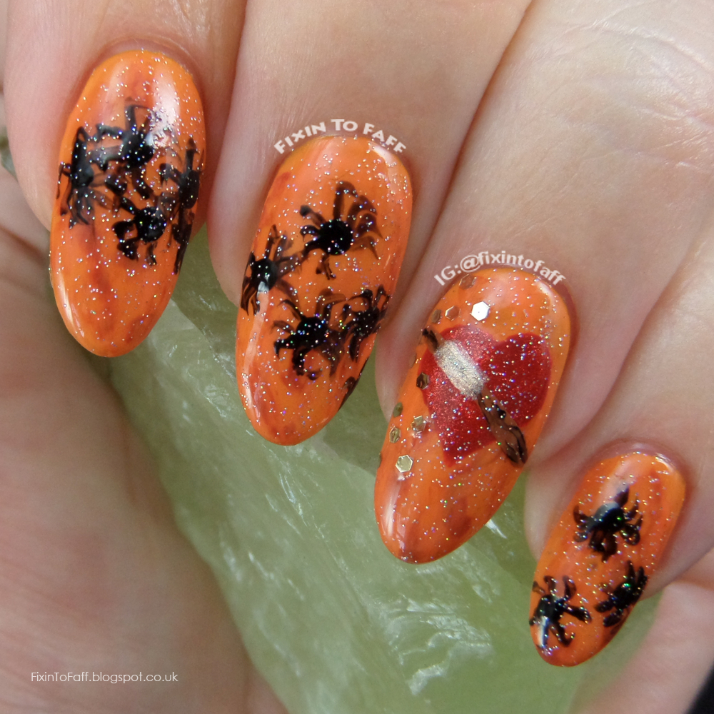 Ginger hair nail art base with freehand heart, broken wand, and spiders to represent Ron Weasley in Harry Potter and the Chamber of Secrets.