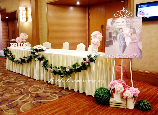 photo table, love corner, garden theme, wedding decoration, hydrangea flowers, artificial, fresh, photo album, frames, strands of grasses, pullman KLCC, grand ballroom, kuala lumpur, selangor, day, mr & mrs, initial, logo, stage backdrop, fairy lighting, dangling flowers, green carpet, bird cages, metal, spotlight, pumpkin carriage, package, custom made, customise, welcome board, wooden crate