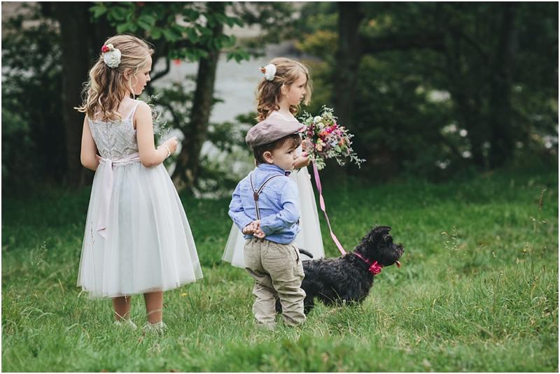 Children and Miniature Schnauzer with wedding flower