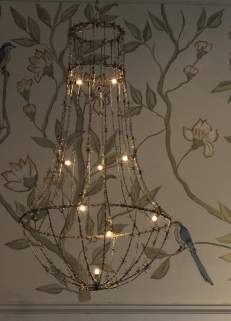 Dishfunctional designs beautiful upcycled barbed wire creations lit barbed wire chandelier via trouvais aloadofball