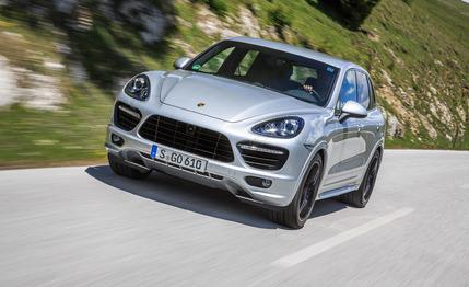 Silver 2013 Porsche Cayenne GTS driving down a mountain road