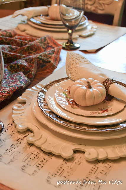 Baby pumpkins, vintage lace napkins and dishes in this cozy breakfast room tour at Postcards from the Ridge.