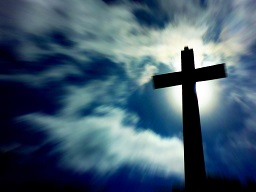 Blurred Clouds and Cross