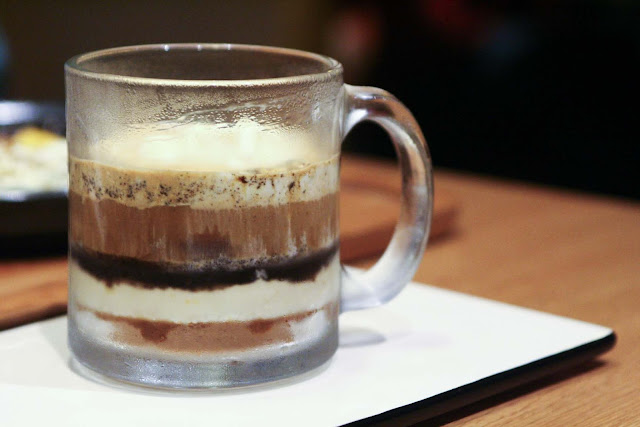 Deconstructed tiramisu in a glass mug