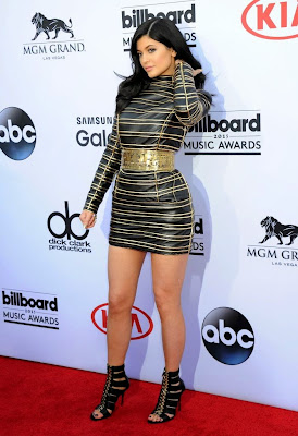 Kylie Jenner wear a sexy black and gold mini dress at 2015 Billboard Music Awards Red Carpet