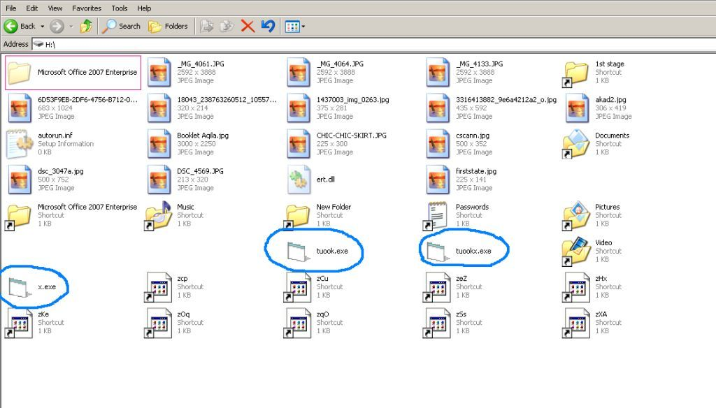 Cara Menghapus Virus Copy of Shortcut + Recycler (W32/Ramnit)
