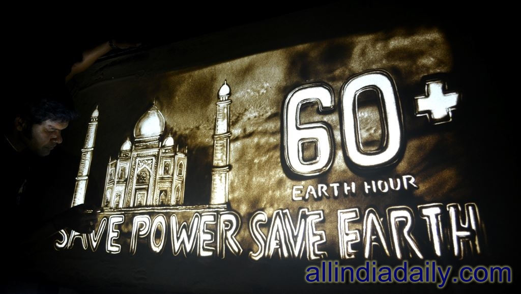sand painting of Taj Mahal on the Earth hour campaign at Puri in Odisha